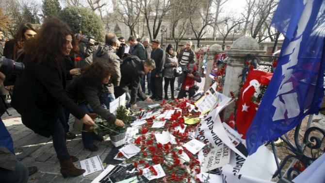 People visit the site of Tuesday's suicide bomb attack at Sultanahmet square in Istanbul,